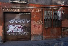 Garage du Palais - Old, abandoned garage opposite of Palais de Justice. A classic in Lyon. Don't like the graffiti, but what can you do? I still wanted to take the shot.