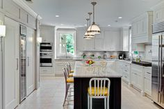 White kitchen with yellow leather bar stools. Kitchen with white dome pendant lights over dark kitchen island with marble countertop Kitchen Glass Doors, Kitchen Stools, White Kitchen Cabinets, Kitchen Countertops, New Kitchen, Kitchen Island, Bar Stools, Kitchen Ideas, Granite Countertop