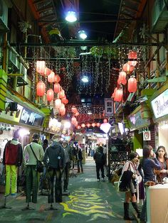 Shilin night market, Taipei, Taiwan. This is by far the most packed on all the night markets in Taiwan, and there's a whole extra food vendot spot under the street (look for the stairs). This is also where you can eat penis waffles.