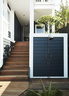 | The Rhapsody | black cladding and outdoor shower.