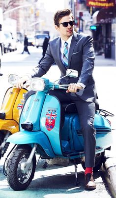 Suit and moped.