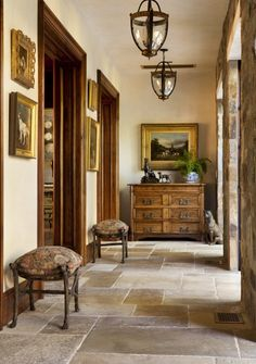 This entryway has it all...check out the floor, the fabulous chest, what looks to be antique stools, artwork everywhere...just great.