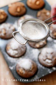 Sifting powdered sugar on gluten-free apple cake muffins ...