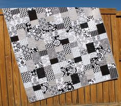 """This beautiful modern quilt was made for you with Lila Tueller's """"Mystique"""" fabric line for Riley Blake. The fabric features various flowers, swirls, patterns and polka dots in black, gray and white."""