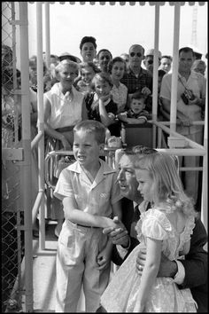 Walt Disney meeting the first young visitors during opening ceremonies at Disneyland, July 17, 1955.