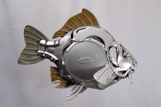 Everyone should have a hubcap fish - this one's mine #fish #fishing #carp #recycle #hubcapcreatures #upcycle