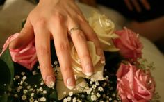 Photo about A hand with wedding ring on a pink and white rose bouquet. White Rose Bouquet, White Roses, Stunning Eyes, Bride Bouquets, Flower Wallpaper, Videography, Marie, Wedding Rings, Stock Photos