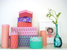 Shoe boxes etc., using fabric and wallpapers....someday all my boxes of keepsakes and family pictures will look like this...even if they're under my bed or in a closet!