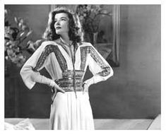 "Photograph of Katharine Hepburn full-length in Adrian gown in ""The Philadelphia Story,"" MGM"