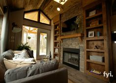 Tiny House Living Room has a big, dramatic stone fireplace and mantle, big wooden built-in cabinets, big stunning entryway, and a big feeling of space. Tiny House Movement, Tiny House Living, Small Living, Living Area, Tiny Living Rooms, Tiny House Nation, Built In Cabinets, Tiny Spaces, Tiny House Plans