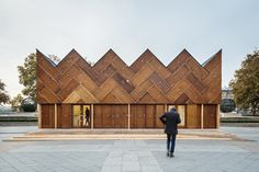 Stunning Parisian pavilion is crafted from 180 recycled wooden doors