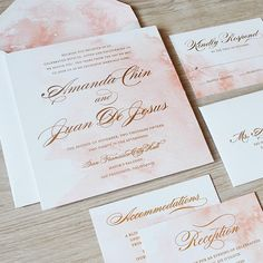 A subtle wash of color adds gorgeous visual interest to an otherwise classic invitation.