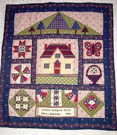 A Welsh Sampler quilt made with Laura Ashley fabrics.  I really like the top panel with the trees in front of the hill.