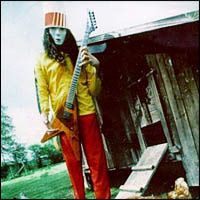 """An instrumentalist, Buckethead is best known for his electric guitar playing. He has been voted number 8 on a list in GuitarOne magazine of the """"Top 10 Greatest Guitar Shredders of All Time"""" as well as being included in Guitar World's lists of the """"25 all-time weirdest guitarists"""" and is also known for being in the """"50 fastest guitarists of all time list"""". Sweet Child O' Mine, Best Guitar Players, Best Guitarist, Present Day, Music Bands, Biography, Handsome, Number 8, Dj"""
