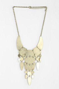 Awesome chunky chain necklace with an oversized metal bib. #urbanoutfitters