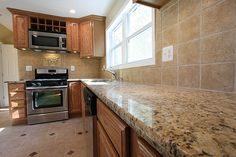 I like the backsplash and countertops, might look good with my oak cabinets...