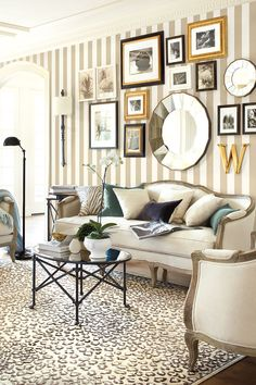 Leopard rug paired with striped wallpaper