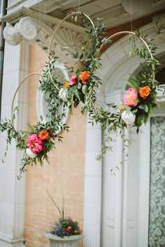 Statice Floral decorated gold hoops with greenery, peonies, and roses to create a modern floral installation at this outdoor party.