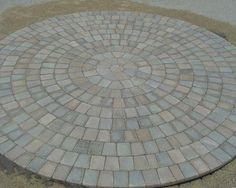 Want to make a perfectly round backyard patio? Create this look using pavers. Circle Kits Available!