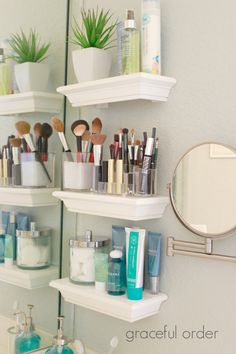 I love this!! The mounted makeup mirror, shelves that give just a little bit of space without taking over the whole space. Great!
