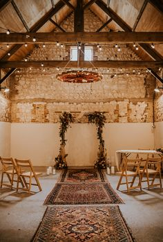 Rustic Wedding Decor with Rugs and Festoon Lighting for Ceremony in Barn   By Aurora Grey   Cabin Wedding   Rustic Wedding   Intimate Wedding   Micro Wedding   Small Wedding   Autumn Wedding   Red Wedding Flowers   Orange Wedding Flowers   Pumpkin Decor for Wedding   Wedding Ceremony Decor   Wedding Altar Decor   Aisle Decor Altar Decorations, Wedding Ceremony Decorations, Decor Wedding, Cabin Wedding, Rustic Wedding, Wedding Isles, Orange Wedding Flowers, Pumpkin Flower, Wedding Altars