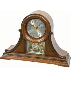Accentuate your mantel or desk with this stunning wood clock, showcasing a beautifully embossed stainless steel dial, crafted with two-tone accents for an exquisite European clock design. Popular melodies. . . When The Saints Go Marching In...