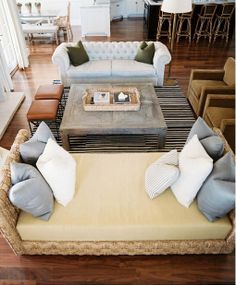beach house - love the reclaimed wood coffee table; sofa across from daybed; striped rug; velvet side chairs; leather stools - Cozy!