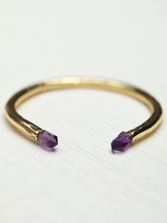 Veronica Crystal Cuff | Hammered 18-karat gold plated metal cuff with an Amethyst embellishment at each end. Adjustable for fit and comfort. This cuff has a lustrously earthen look that is a perfect mix of edgy and refined.   *By Beso Beso
