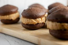 If you love soft chocolate cake, peanut butter buttercream filling and happiness then you are going to super love these Chocolate Peanut Butter Buttercream Whoopie Pies.  When you take your first bi