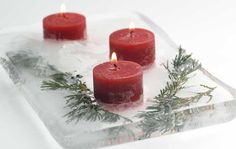 Fire and Ice: an easy DIY centerpiece for the holidays—just freeze candles and evergreen cuttings in a block of ice!