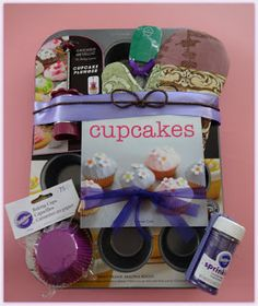Cupcake tin, hot mitt, liners, sprinkles, scraper/mixer spoon & cupcake recipe booklette! House warming gift idea.