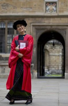 Myanmar democracy icon Aung San Suu Kyi poses for photographers at the Bodleian Libraries after receiving an honorary degree at Oxford University in Oxford, northwest of London, on June 20, 2012. Suu Kyi was awarded an honorary doctorate by Oxford University on June 20 in the city where she studied and brought up the family she would later leave behind.