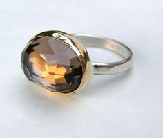 Stunning brown smoky quartz #ring. It's encased in a silver bezel order. Handmade and oh so beautiful.