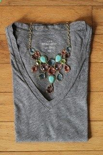 gray tee, statement necklace.