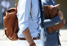 Pinstripe shirt, white pants, navy tie, & leather accessories