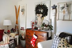 Farmhouse cabin Christmas Home Tour with lots of greenery, naturals, white and a bit of sparkle.