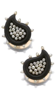 Pair of ebony, cultured pearl and diamond ear clips, JAR Each of paisley design, set with carved ebony decorated with cultured pearls studded with brilliant-cut diamonds, signed JAR Paris, French assay and maker's marks.