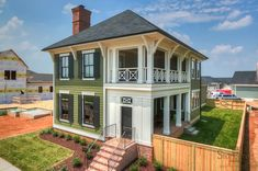 Charleston Style home with double porch and brick fireplace.