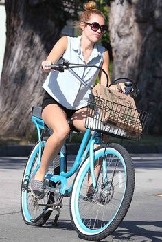 Miley Cyrus using a Pedego to run errands.