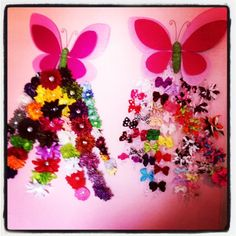My darling angel has over 50 hair clips (bows, flowers & korkers) that I hated sorting through, so I decided to make them part of her butterfly themed room decor and make them easy to find. Attatched strands of ribbon to large to oversized butterflies.
