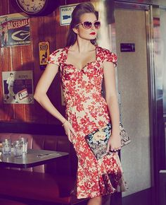 Go for a retro chic look in a floral dress by Zac Posen.
