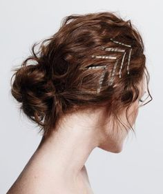 This chic chevron pattern works on hair of any texture. First Warren gathered the model's dry hair into a low, loose bun. Then he scrunched a golf ball–size amount of mousse through the hair to give the pins something to grip onto. Next, he slid the pins in, two at a time.