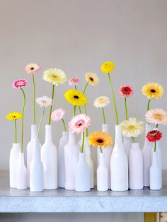 colorful gerbera daisies in milk glass vases Fresh Flowers, Beautiful Flowers, Happy Flowers, Decoration Evenementielle, Wedding Decorations, Table Decorations, Deco Floral, Bottle Crafts, Floral Arrangements