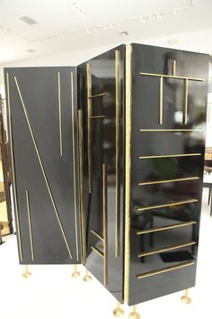 > This striking and modernist three-panel screen finished in deep brown lacquer has raised brass patterning on both sides and is set on stylish brass feet. Designed and manufactured by Frank Kyle of Mexico City this screen is a show stopper <  Lacquer & Brass Divider by Frank Kyle 8