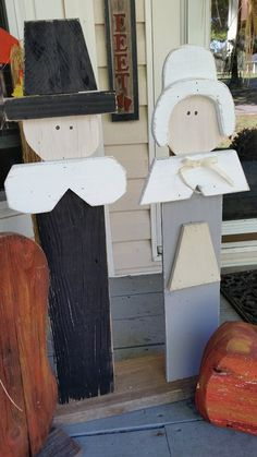 "RECYCLED WOOD PALLETS: We are selling this pair of Pilgrims, $34. These porch sitters are 33"" tall and 10"" wide and are attached to a solid wood base. Message us if you would like to order a pair of these. Item # 383"