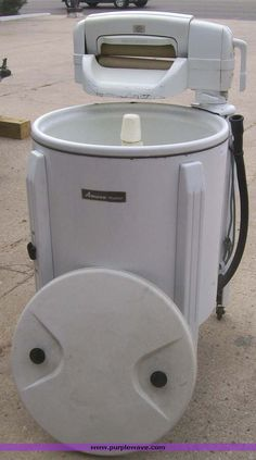 You washed your clothes in a wringer washer!   I remember watching my mom wash clothes with one of these