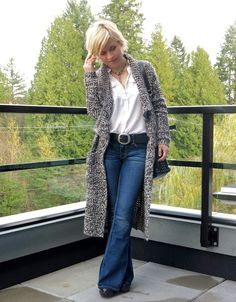 styling flare jeans with a white shirt, cardigan coat, and Michael Kors bag