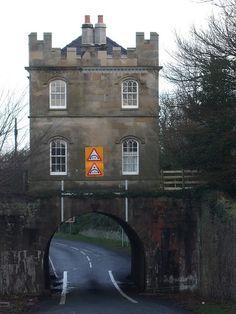 """Dry Bridge Lodge"" built over the road near Mostyn Hall, Wales"