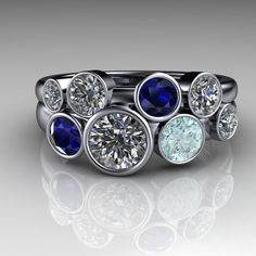 Ethically sourced diamonds and sapphires set in platinum.