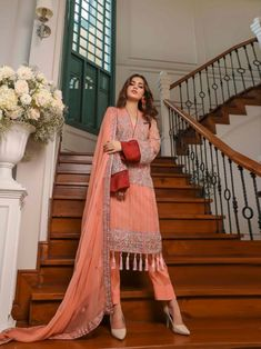 Radiant peach embroidery straight cut suit online which is crafted from chiffon fabric with exclusive embroidery. This stunning designer straight cut suit comes with raw silk bottom and chiffon dupatta. Women's A Line Dresses, Gowns Online, Straight Cut, Chiffon Fabric, Evening Gowns, Wedding Gowns, Peach, Embroidery, Suits